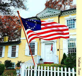 A colonial flag waves in the breeze outside Laurel Hill Mansion.