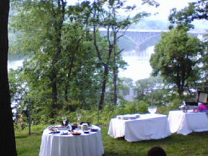 Tables covered in white linen make a lovely site in the garden at Laurel Hill Mansion